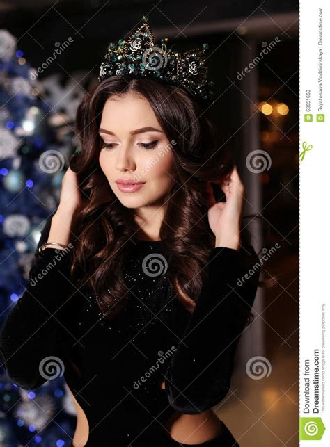 dark haired beautiful women modeling clothes sensual woman wears elegant dress posing beside decorated