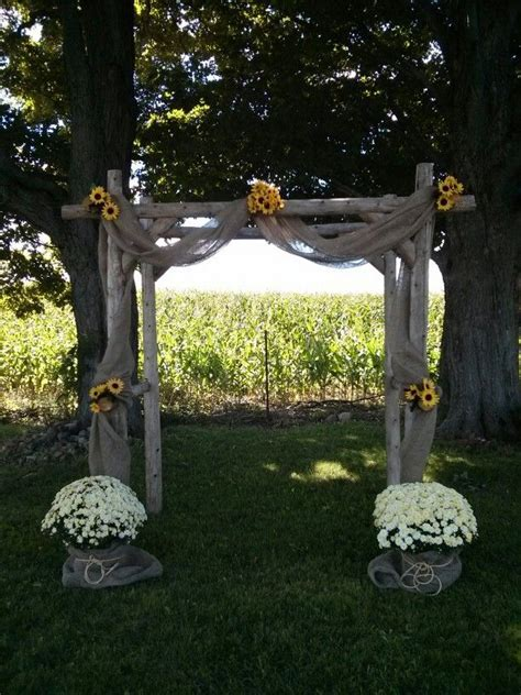 DIY Summer country rustic wedding arch. Sunflower and