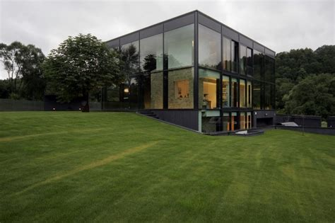 antique building wrapped in modern glass house box