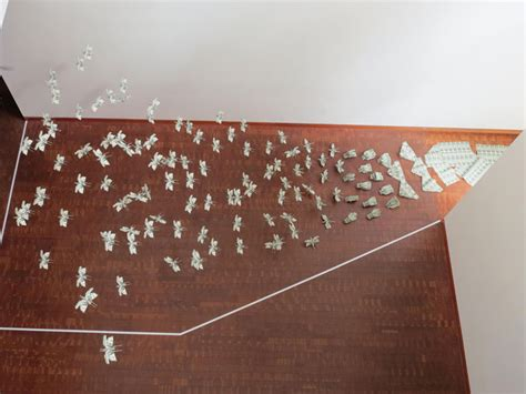 sipho mabona s swarm of flying money origami locusts r u