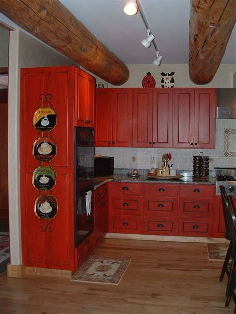 red kitchen cabinets with black glaze bright red distressed cabinets with black accent glaze