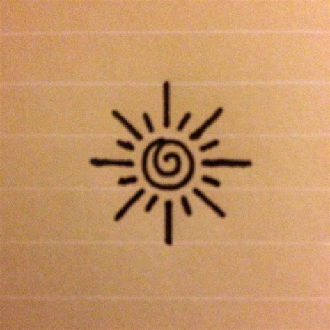 small and simple tattoos this is a small simple design of a sun perhaps for an