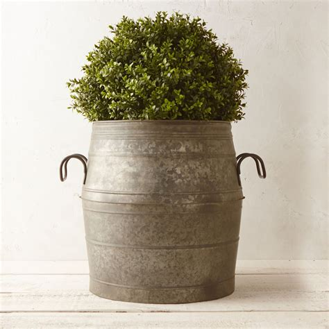 Metal Planters galvanized metal barrel planter the green