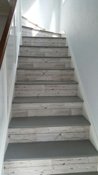 wood plank tile on staircase with white painted railings ideas 27 painted staircase ideas which make your stairs look new
