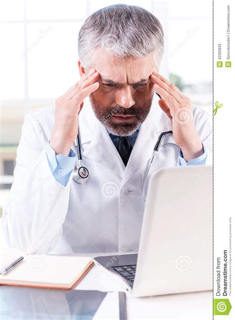 tying up hair headaches scientific scribbles stressed and tired doctor stock photo image 42330933