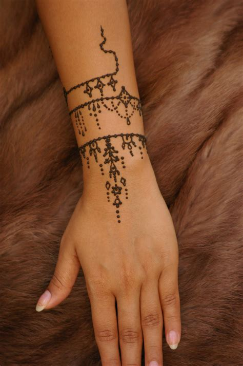 white henna tattoo on hand simple henna on