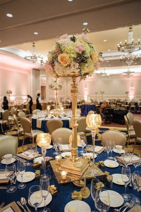 Polished navy blue, gold, and blush wedding reception