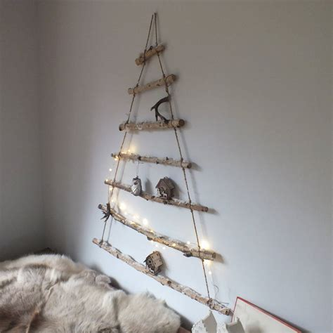 hanging christmas tree snowy branch hanging christmas tree by magpie living