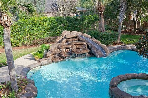 rustic swimming pool with pool with hot tub exterior stone floors in houston tx zillow digs