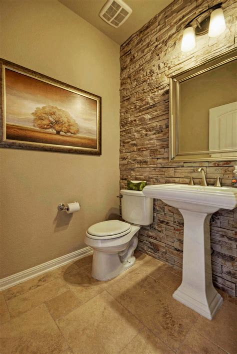 stone accent wall in the bathroom adds class and needs minimal decorations get the look with our