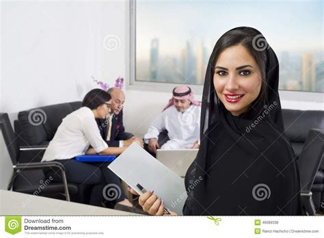 Mba Banking In Dubai by Arabian Businesswoman With Employees Meeting In The