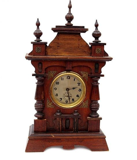 A Small Table Clock With Alarm Historicism Small Desk Clock