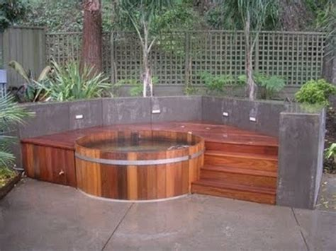 round tub with raised deck 48 awesome garden hot tub designs digsdigs backyard pinterest
