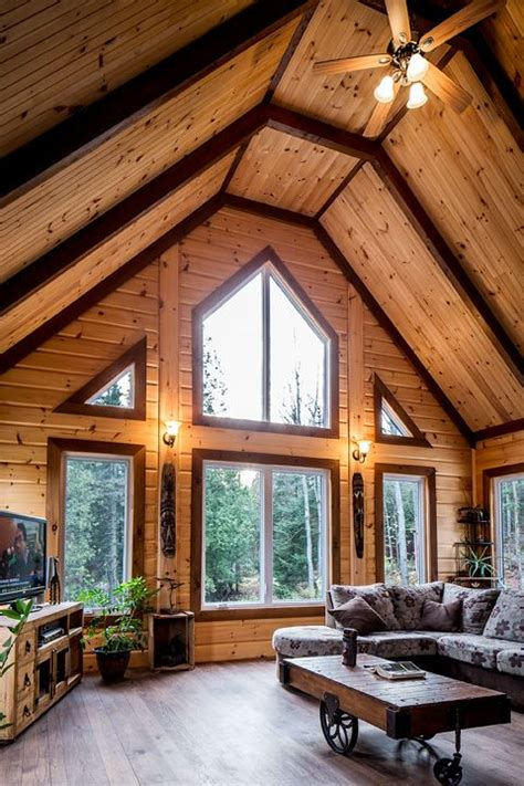 Log Homes Interior Designs using different stain colors on your log home interior
