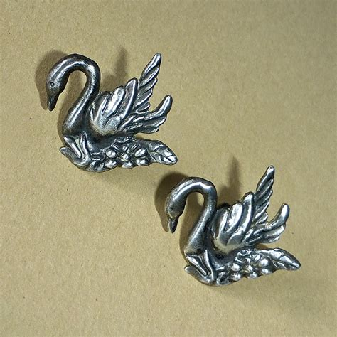 Sterling Silver Swan Earring sterling silver repousse swan earrings from bejewelled on