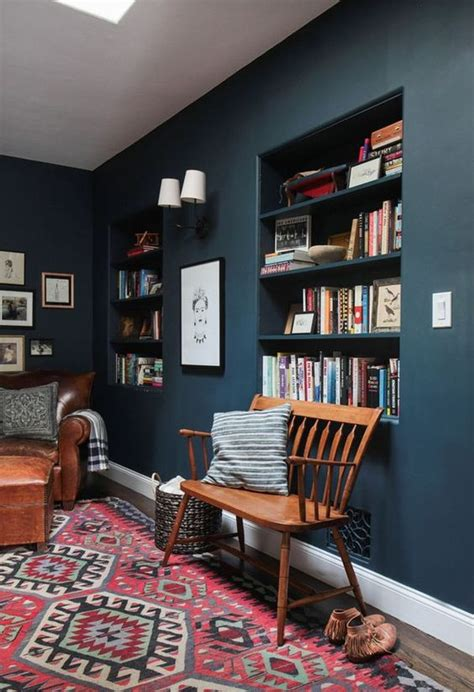 emily henderson hague blue reading nook leather chair gallery wall bookshelves living