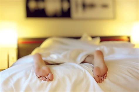 sleeping in my bed free photo sleeping tired bed feet free image on