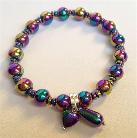 rainbow coated hematite bracelet stretchy with charm