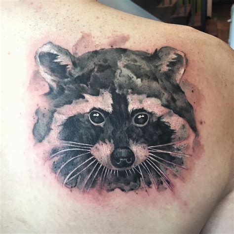 level up tattoo racoon blackwork level up studio