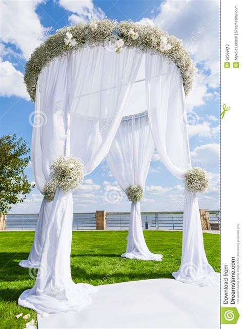 Wedding Arch Images by Wedding Setting On A Green Lawn White Wedding Arch Stock