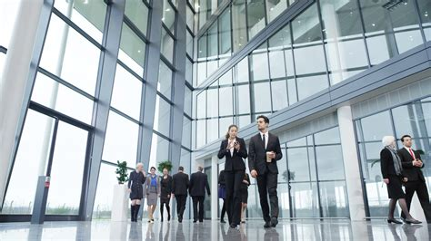 walking business business walking in a crowded office lobby stock footage videoblocks