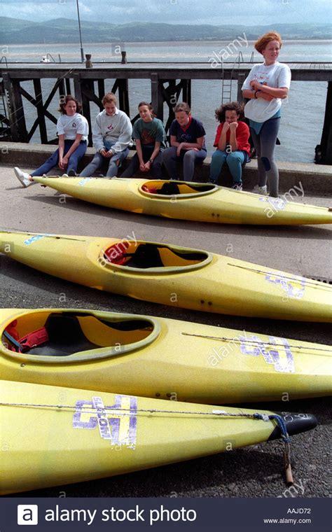 canoes exercise outward bound aberdovey stock photos outward bound
