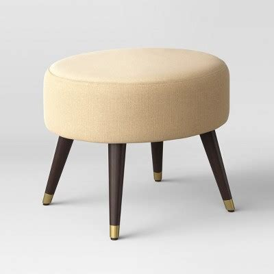ottoman with gold legs farwell oval ottoman beige with gold cap leg project 62