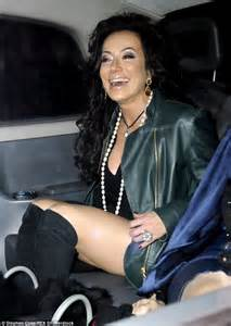 Nancy dell olio in raunchy thigh high boots as she attends restaurant