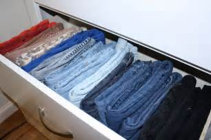Showroom style and use shower curtain hooks to hang up your jeans