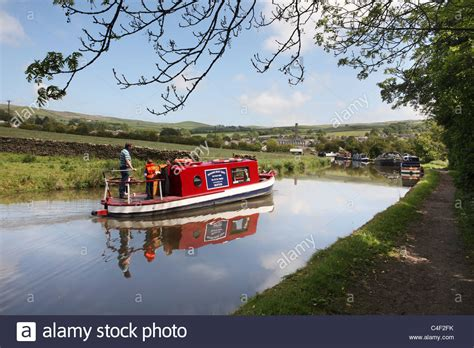 buy a boat leeds a family on a canal narrow boat on the leeds and liverpool