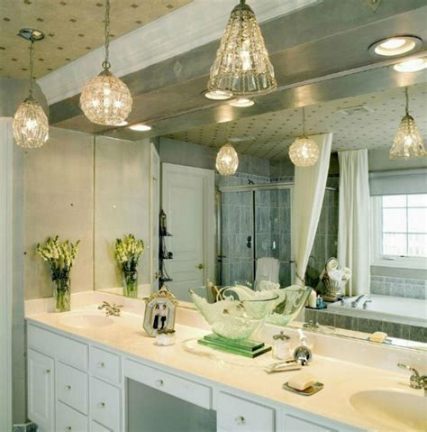 bathroom light fixtures mirror the suspension lighting for a luxury bathroom