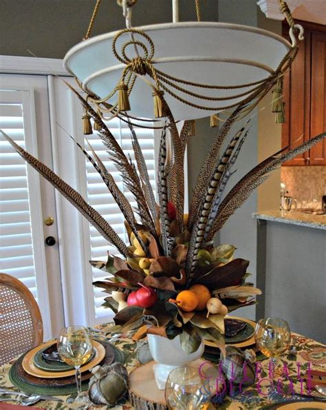 fall centerpieces with feathers how to make a fall centerpiece with magnolia leaves hometalk