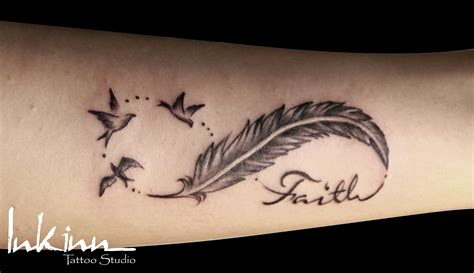 feather tattoo meaning faith 33 awesome pigeon feather tattoos