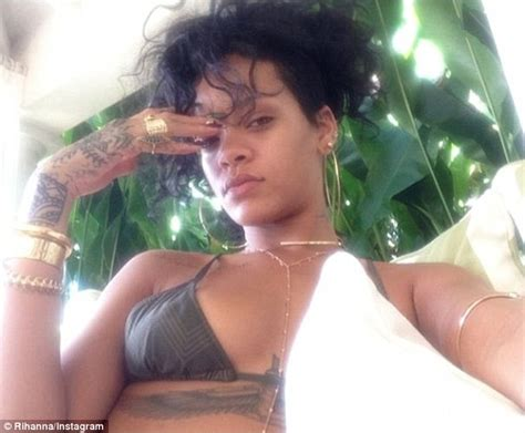 Rihanna shares instagram picture of her smoking a roll up and flashing