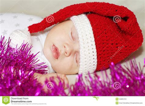 New From Lovely Lovely by Lovely Baby In New Year S Hat Sleeps Among Spangle Stock