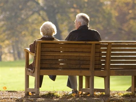old couple on bench elderly couples can hear their partner s voice more