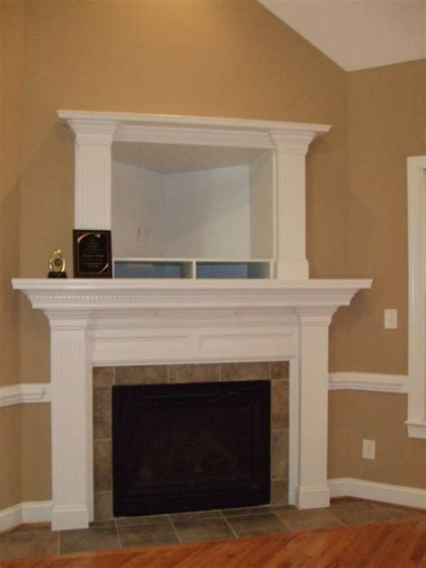 Corner Fireplaces With Tv Above by Fireplace Designs With Tv Above
