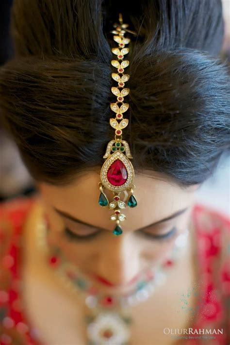 Exquisite gold and jeweled hair ornamentation.   Tribal