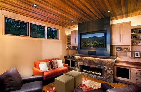 family room tv contemporary family room makes best possible use of space with tv above the fireplace decoist