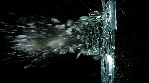 In Motion motion destroying sheet of glass stock footage