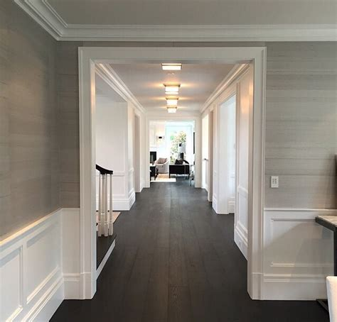 gap interiors classic hallway with wallpaper above dado grass cloth wallpaper wainscoting dining room