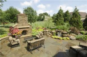 Stone Patio With Fireplace by Tuscan Backyard Terrace Landscaping Network