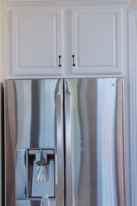 diy painting oak kitchen cabinets white how i painted my boring oak kitchen cabinets white the