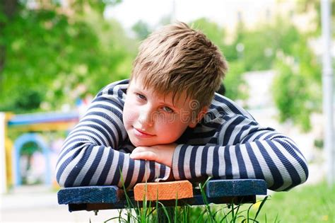 lay bench boy lay on a bench in the park stock image image 9628101