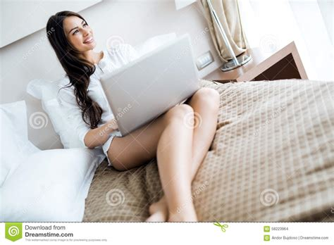 how to be sexier in bed beautiful woman with long legs in shirt using a notebook