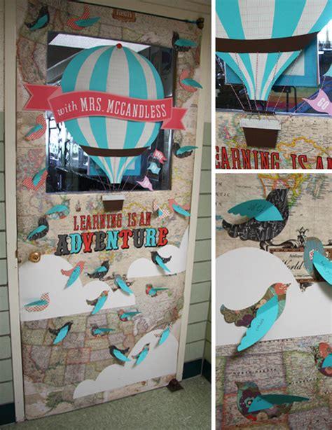 newspaper themed classroom teacher appreciation door decor with paper airplanes