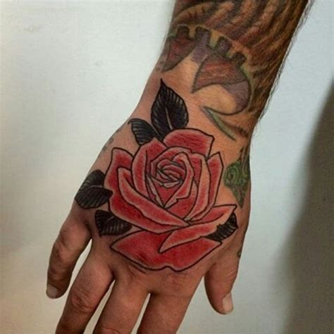 hand tattoo red red rose tattoo on right hand by max may tattoo