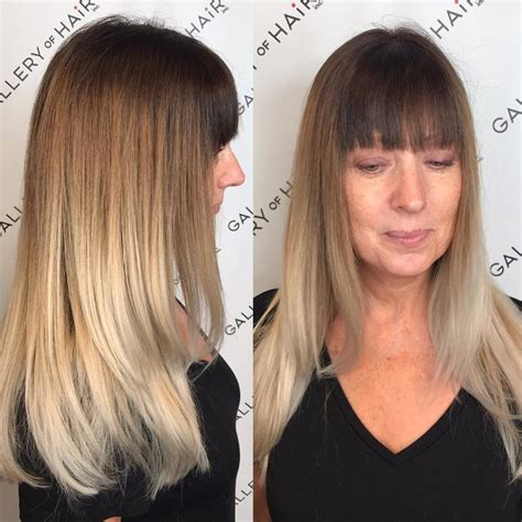 great layered blunt cut with bangs women s long layered cut with blunt bangs and multi tone