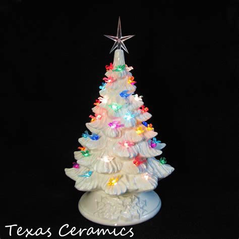 white ceramic christmas tree with colorful dove bird lights 16