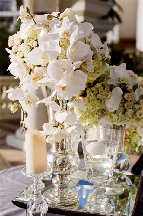 Gorgeous Mercury Glass Vases With White Flower Bouquets On Glass Mirrors For Centerpieces
